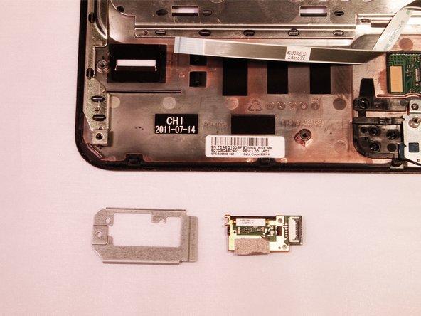 Release ZIF connector on fingerprint reader and remove fingerprint reader board.