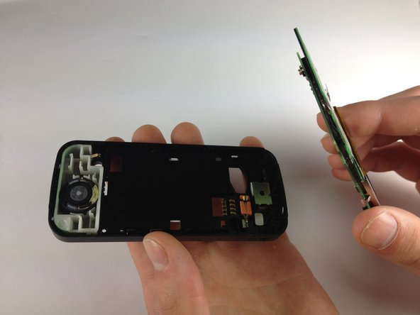 Insert a spudger at the bottom of the phone, between the phone's frame and the circuit board.