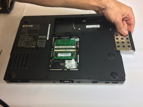 Using your hand, pull hard drive out of the laptop.