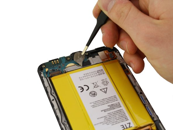 Use tweezers to peel off the tape at the bottom of the phone.