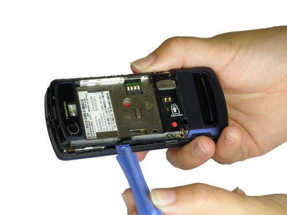 Image 1/2: Pull the plastic casing directly away from the phone.