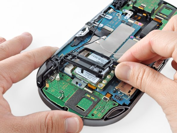 Peel up and remove the wireless card casing.
