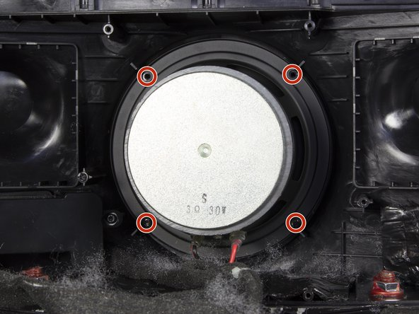 Remove the four 10mm screws that secure the rear speaker with a TR 10 driver.