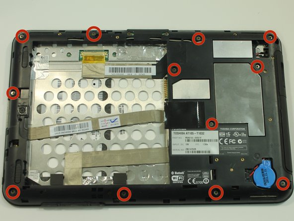 Start by using a PH0 phillips head screwdriver to remove the 12 screws holding on the back cover
