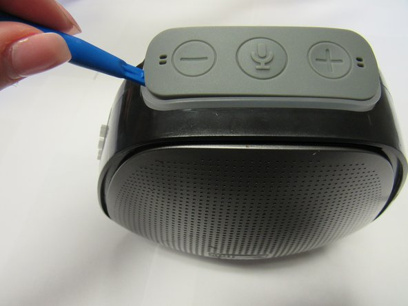 Orient speaker so volume buttons are facing up.