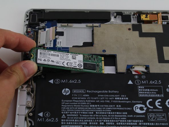 Slightly lift the card up and then remove the SSD card from the device.