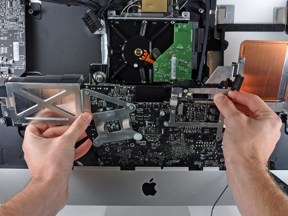 Carefully pull the logic board slightly away from the outer case.