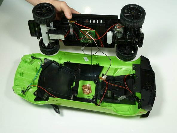 Image 2/2: Lift up the body to expose the wiring and hardware underneath.