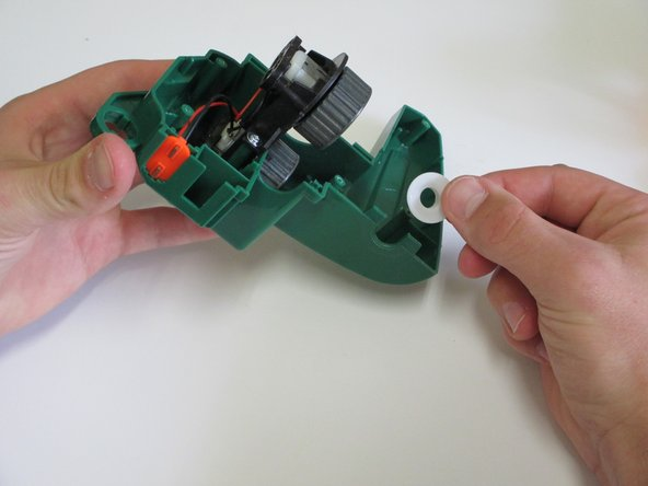 Image 1/1: Remove the bushing by simply pulling it away from the plastic.