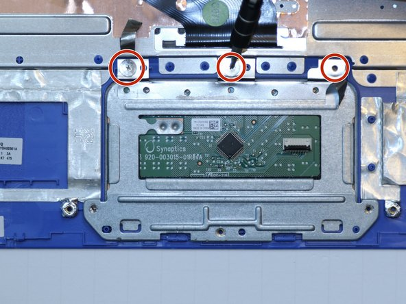 Use a Phillips #00 screwdriver to unscrew three 1.5 millimeter screws from the trackpad.