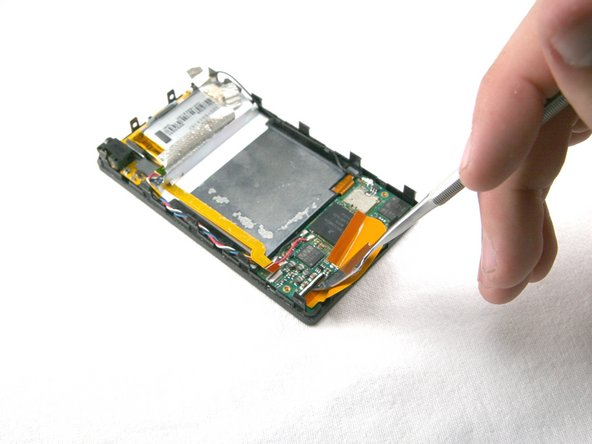 Flip the black bar to unclip the left side of the hard drive cable. You can now remove the hard drive cable.