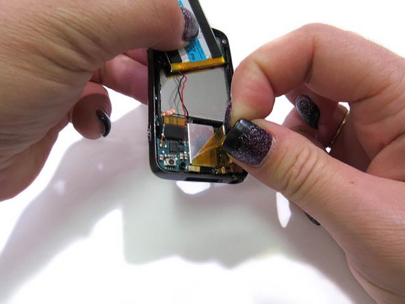 Remove the yellow film covering the circuit board with pointed precision tweezers.