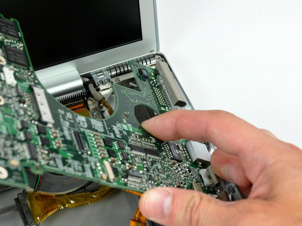 The logic board on this model has a tendency to get caught on the lower case near the DVI port at the upper right corner. If it catches as you are rotating it, stop to avoid bending and breaking the logic board.