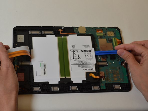 Use a plastic opening tool to pry up the battery.
