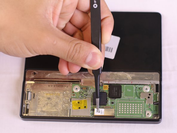 Locate the connector from the display screen on the motherboard and disconnect it with tweezers