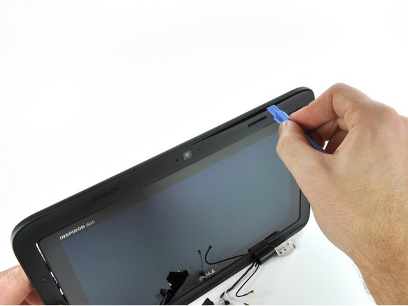 Image 1/3: A 1.3 megapixel webcam sits above the display when the Inspiron Duo is in netbook mode. However, it's hidden when the screen is flipped around, leaving the Samsung Galaxy Tab as the lone picture-capable tablet, [http://www.macrumors.com/2010/12/10/reuters-reports-next-generation-ipad-to-offer-front-and-rear-cameras/|for now...]