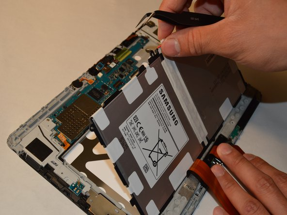 Detach the battery by gently lifting the battery out of the panel.