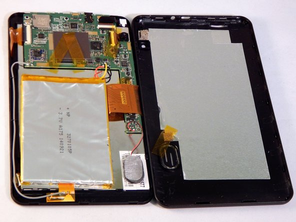 The back panel should now be disconnected from the device. This provides access to the components of the device for repairing and replacing parts of the tablet.