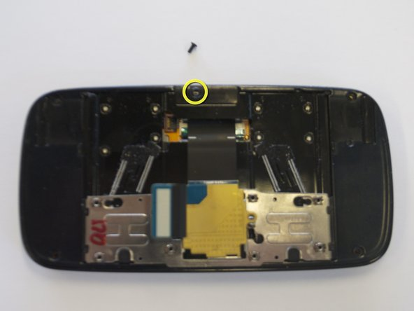 Slide the phone apart, and remove a 5th screw (3.5 mm).