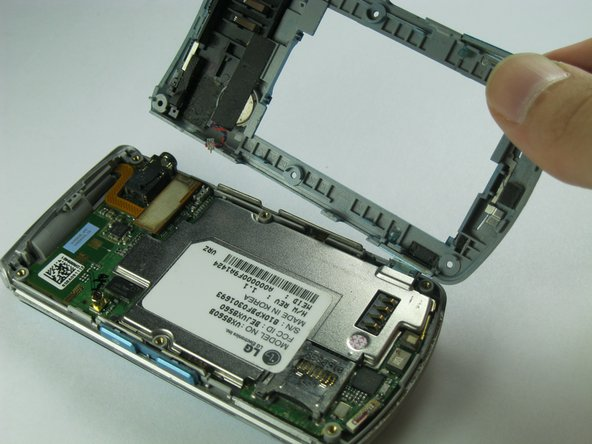 Carefully remove the rear case from the phone.