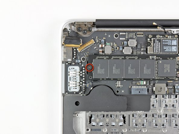Remove the single 2.85 mm T5 Torx screw securing the SSD to the logic board.