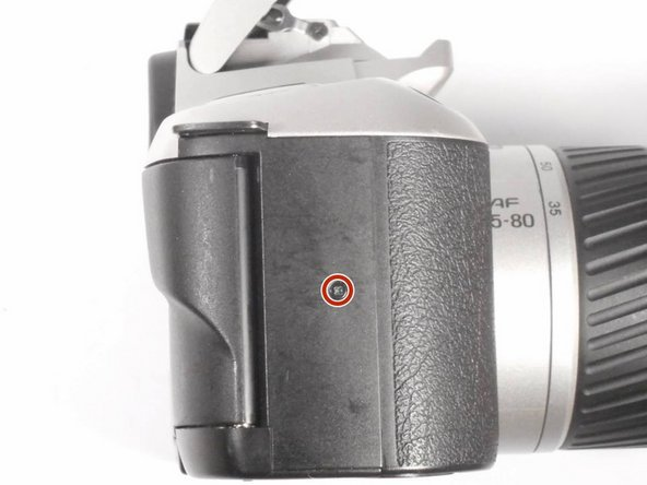 Remove the (1) Phillips #00 5mm screw on the left side panel of the camera.