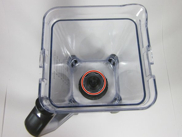 Carefully pick up the new blade and match the bottom star shaped opening to the star shaped protrusion from the blender.