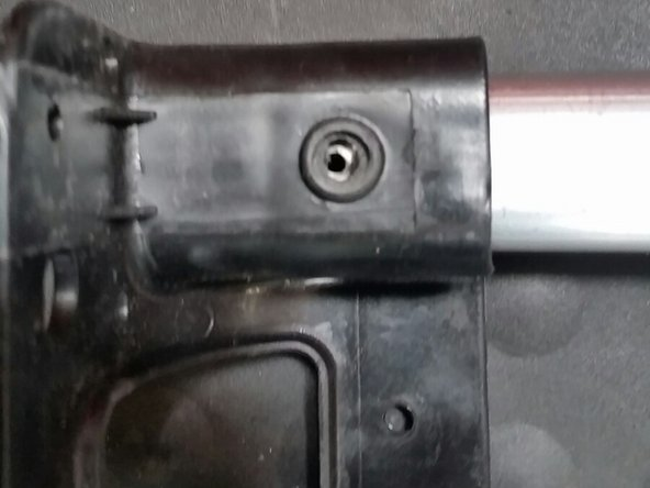 *frustration reducing tip* Although the handle can reach all the way back to the base,  push the new handle ALMOST to the end and line up the smaller hole with the bigger hole as shown in the picture.
