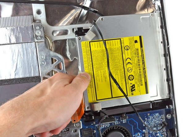 Reach behind the chassis and use your finger to unclip the lower optical drive tab from the chassis.
