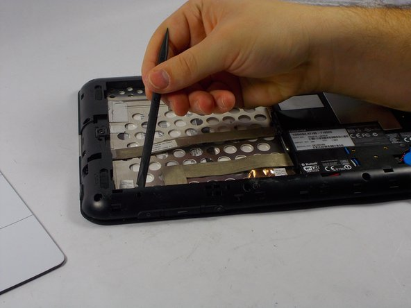 Locate and remove the 14 screws that are located along the outer edge of the tablet. To do this use the a phillips #0 screwdriver.