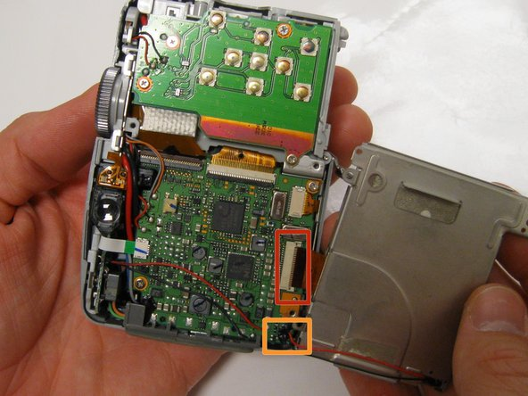 Carefully lift and turnover the LCD Screen so that you are able to see the motherboard.