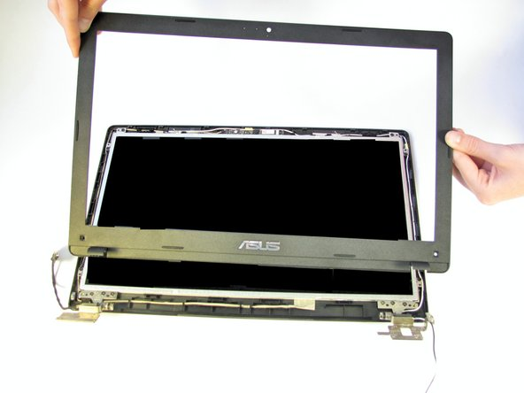 Once pried away from the back bezel, the front bezel will easily lift away from the LCD.