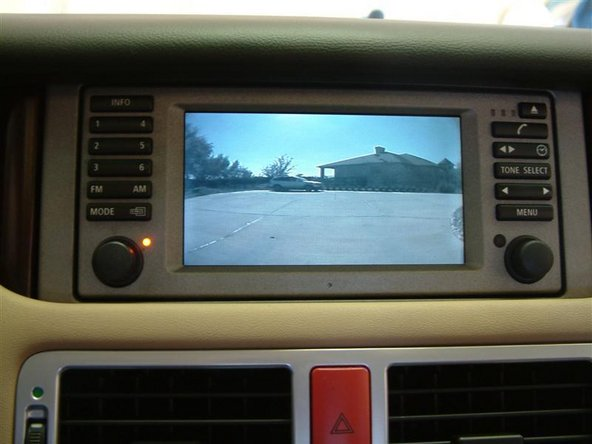 Image 1/2: In the BMW E46 E38 E39 X5 Z4 X3 and Range Rover with the television module you can easily connect a reverse backup camera providing you with full backup camera function on your BMW Display