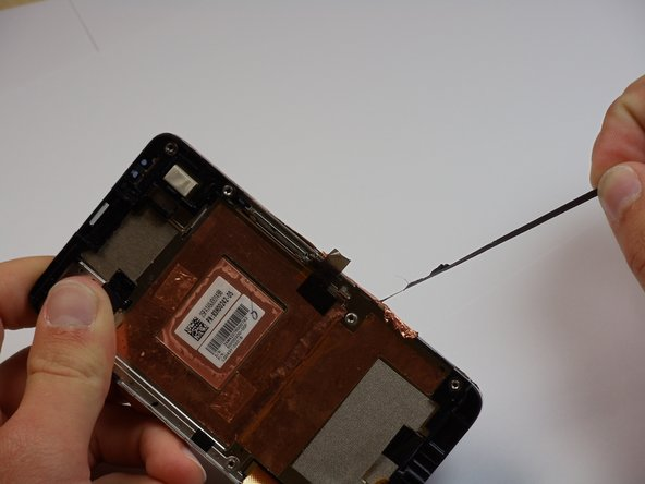Once heating is done, carfully peel the covering along the sides of the phone away.