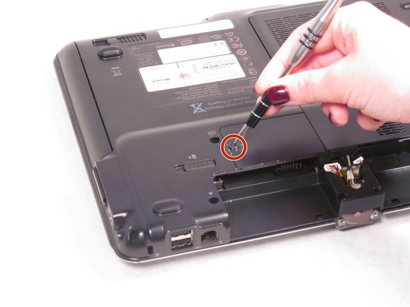 Using the Phillips #0 screwdriver, remove the 4.5 mm screw from the WLAN model screen.