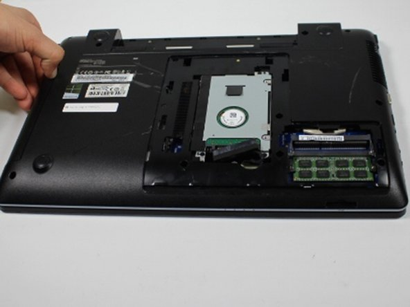 Using your fingernail or spudger to gently pull your optical drive out.