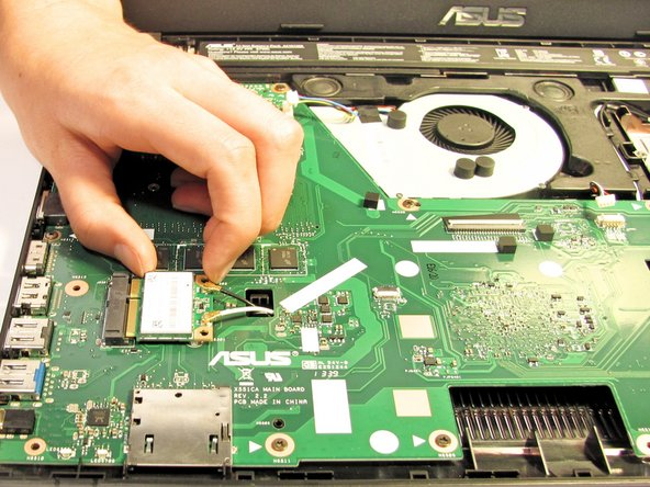Disconnect the Wifi card from the motherboard by gently sliding it towards the right edge of the laptop.