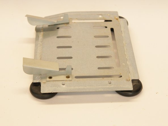 Remove the bottom plate from the main body of the toaster.