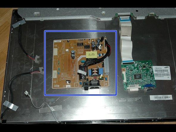Carefully remove adhesive strips, release the cables to LCD and front panel buttons.