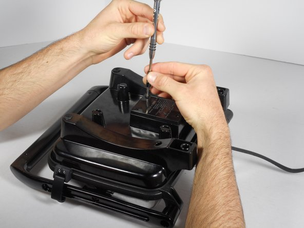 Remove the four 14mm screws from the bottom of the Panini Press using the T10 Screwdriver.