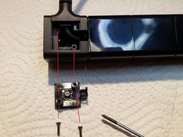Image 3/3: Unscrew two PH0 Screws and pull off the cable holder.