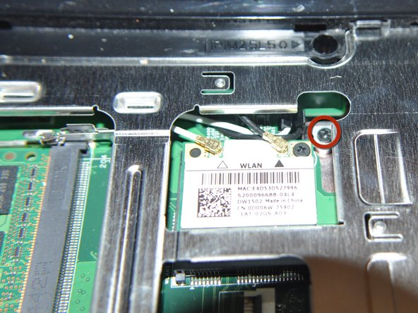 Unscrew the screw next to the wireless card.