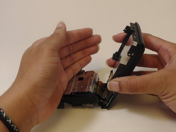 Now remove the LCD screen by bringing the back cover over to the left so that the LCD screen falls into your hand.