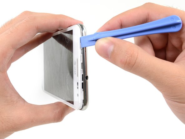 Continue to run the plastic opening tool around the perimeter of the phone until the midframe is separated.