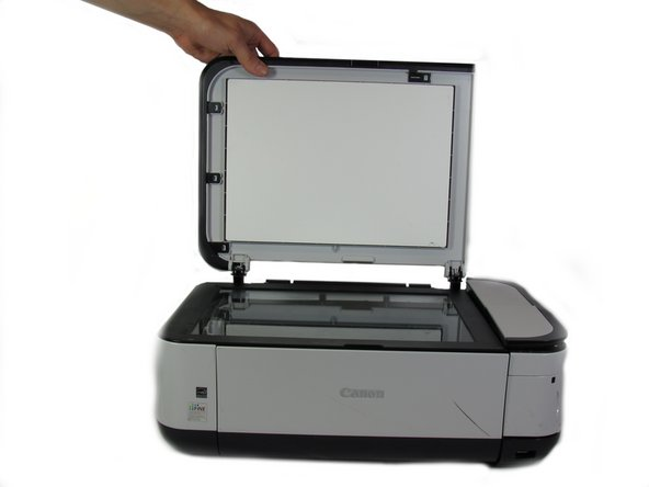 Pull the scanner cover straight up and it will come off.