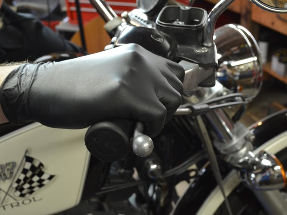 Carefully pump the brake lever a few times to build up pressure in the brake lines.