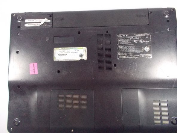 "Flip laptop over so that ""Service TAG"" is at the top left."