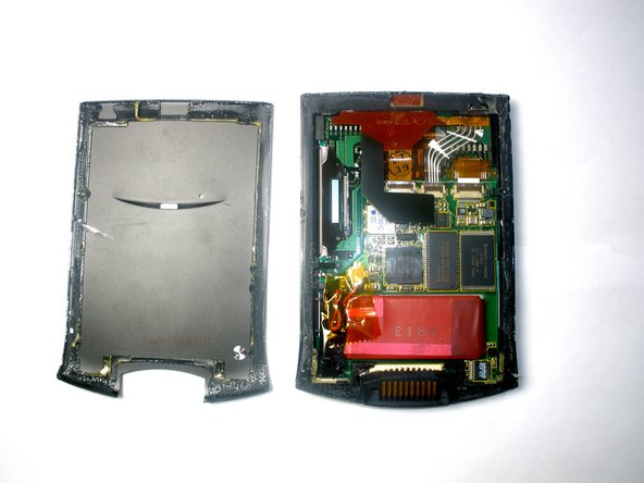 If the back case has already been removed, carefully place it on the WorkPad to protect the circuitry inside from the heat.