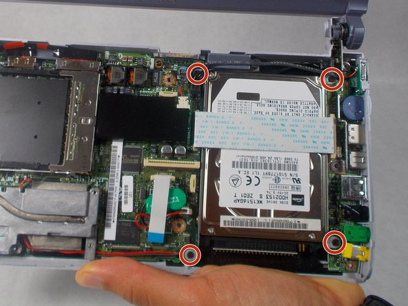 Remove the four 5 mm screws holding the hard drive to the motherboard.