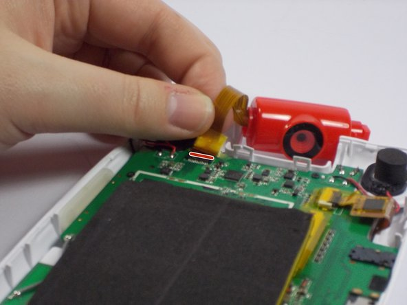 Place the new camera piece in place of the old and plug its ribbon cable back into the respective slot on the board.